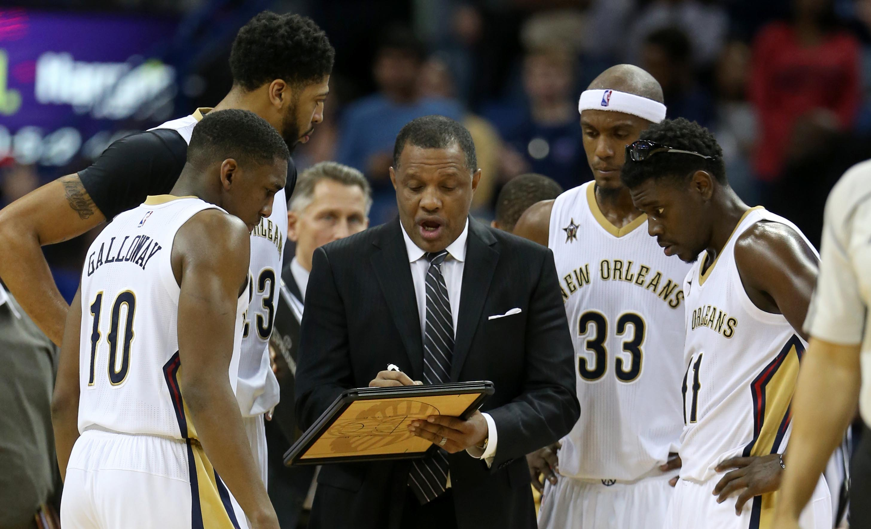 Nov 19, 2016; New Orleans, LA, USA; New Orleans Pelicans head coach Alvin Gentry talks to his players in overtime against the Charlotte Hornets at the Smoothie King Center. The Pelicans won in overtime, 121-116. Mandatory Credit: Chuck Cook-USA TODAY Sports